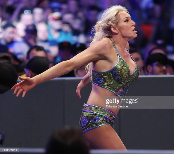 Charlotte Flair runs during WrestleMania 33 on Sunday April 2 2017 at Camping World Stadium in Orlando Fla