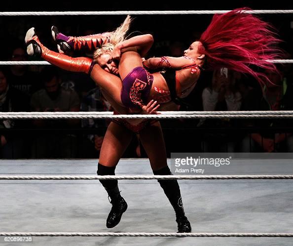 Charlotte Flair takes down Sascha Banks in their match during the WWE Live Munich event at Olympiahalle on November 3 2016 in Munich Germany