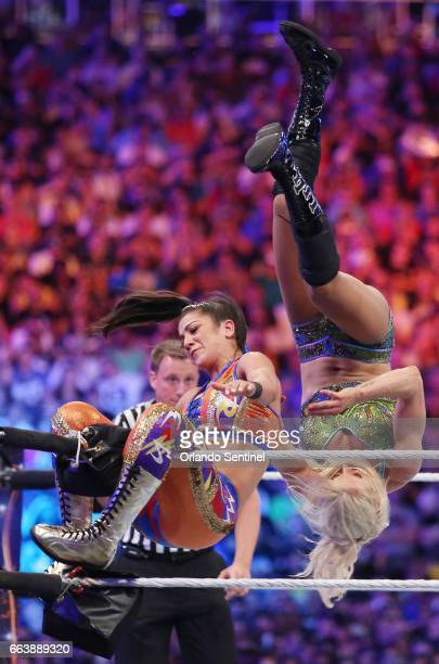Charlotte Flair top and Bayley left wrestle during WrestleMania 33 on Sunday April 2 2017 at Camping World Stadium in Orlando Fla