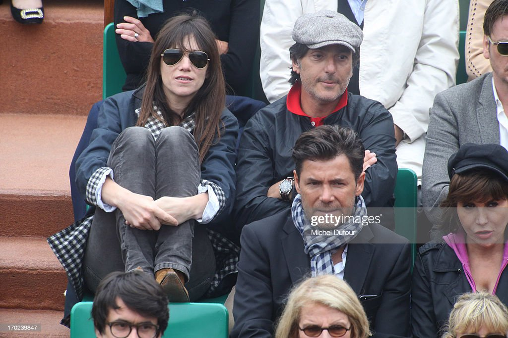 <a gi-track='captionPersonalityLinkClicked' href=/galleries/search?phrase=Charlotte+Gainsbourg&family=editorial&specificpeople=243034 ng-click='$event.stopPropagation()'>Charlotte Gainsbourg</a> and <a gi-track='captionPersonalityLinkClicked' href=/galleries/search?phrase=Yvan+Attal&family=editorial&specificpeople=2360262 ng-click='$event.stopPropagation()'>Yvan Attal</a> are seen attending the French Open 2013 - Day 15 at Roland Garros on June 9, 2013 in Paris, France.