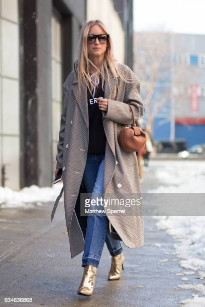 Charlotte Groeneveld is seen attending MILLY during New York Fashion Week wearing a long coat with blue jeans and gold shoes on February 10 2017 in...