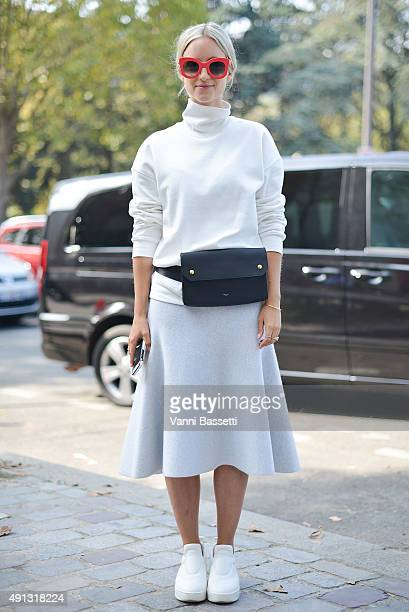 Charlotte Groeneveld poses wearing Celine bag skirt and shoes and Other Stories sweatshirt before the Celine show at the Tennis Club de Paris during...