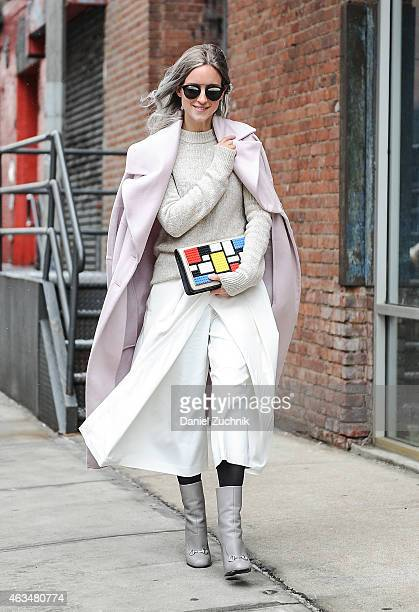 Charlotte Groeneveld walks outside the Tibi show wearing a Michelle Waugh coat Tibi dress Zara sweater Les Petits Joueurs bag Gucci boots and Dior...