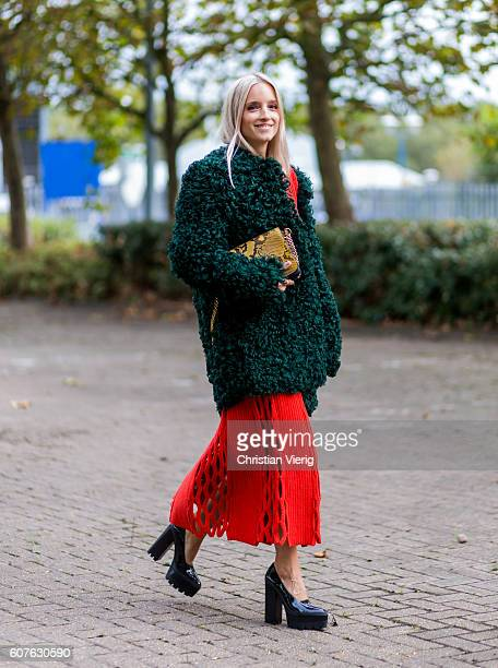 Charlotte Groeneveld wearing a green fur jacket and red dress outside Mulberry during London Fashion Week Spring/Summer collections 2017 on September...