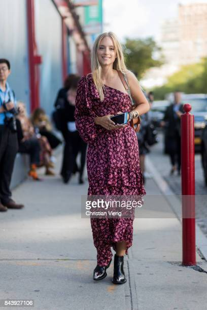 Charlotte Groeneveld wearing a ripped off shoulder dress een wearing in the streets of Manhattan outside Ulla Johnson during New York Fashion Week on...