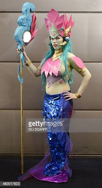 Charlotte Harris dressed as River Spirit Nami from League of Legends attends the second day of the MCM Comic Con in the Manchester Central exhibition...