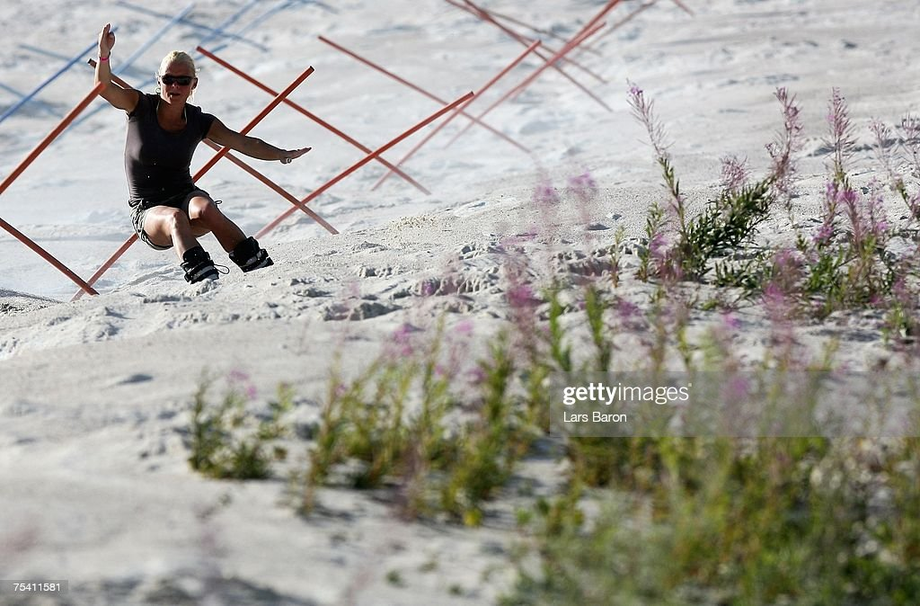 Charlotte Hassepass of Germany trains in the Slalomcourse during the Sandboarding World Championship 2007 at the Monte Kaolino on July 14, 2007 in Hirschau, Germany.