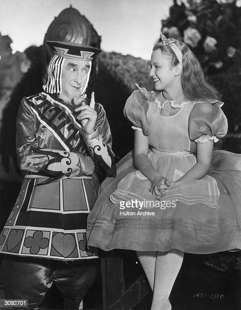 Charlotte Henry plays Alice in a debate with Alec B Francis as the King of Hearts in a scene from Paramount's 'Alice in Wonderland' directed by...