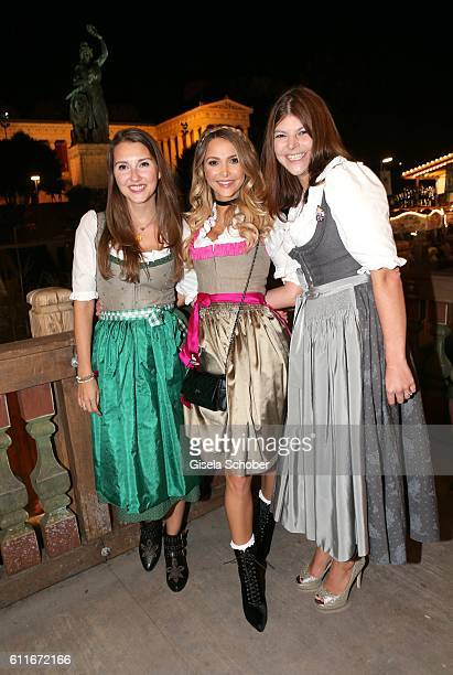 Charlotte Hermann and her sister Sophie Hermann and stepsister Julia Tewaag Julia Frank daughter of Uschi Glas during the Oktoberfest at...