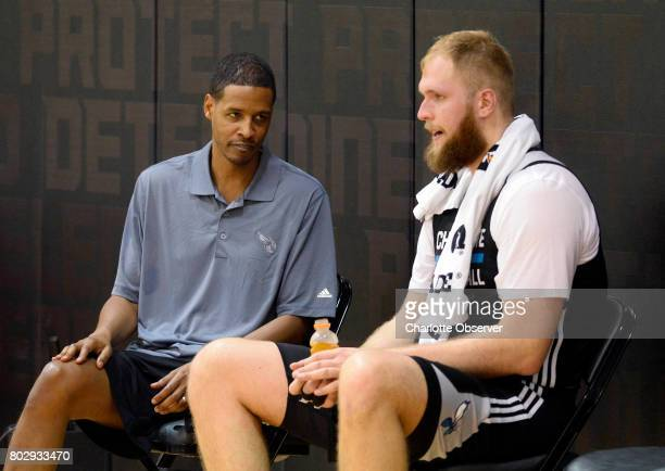 Charlotte Hornets assistant coach Stephen Silas left talks with Przemek Karnowski after practice at the Spectrum Center in Charlotte NC on Wednesday...