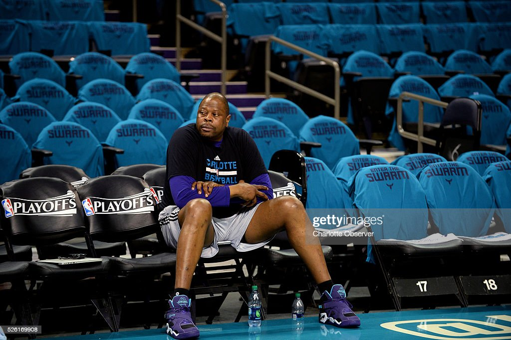 Charlotte Hornets associate head coach Patrick Ewing sits on the team's sideline as players begin a warm up prior to action against the Miami Heat in Game 6 of the Eastern Conference quarterfinals on Friday, April 29, 2016, at Time Warner Cable Arena in Charlotte, N.C.
