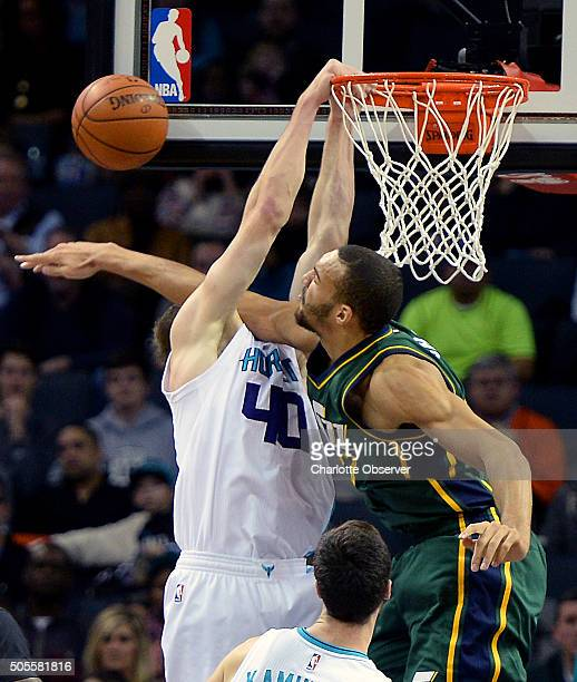 Charlotte Hornets center Cody Zeller right appears to have lost his head as Utah Jazz center Rudy Gobert right goes for a block during first half...