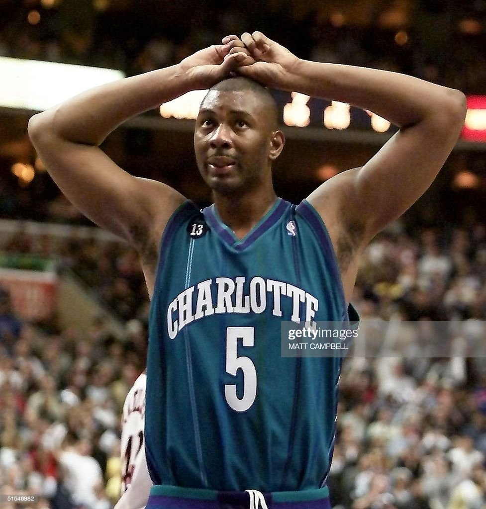 Charlotte Hornets center Elden Campbell walks off