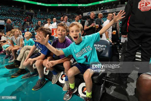 Charlotte Hornets fans cheer on the team during the game against the Atlanta Hawks on October 20 2017 at Spectrum Center in Charlotte North Carolina...