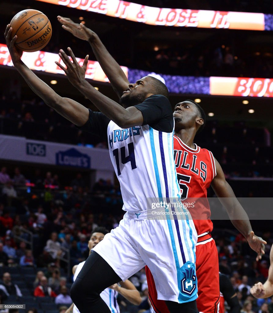 Charlotte Hornets forward Michael Kidd-Gilchrist, left, drives to the basket for two points as Chicago Bulls forward Bobby Portis, right, applies defensive pressure during second half action against the Chicago Bulls on Monday, March 13, 2017 at the Spectrum Center in Charlotte, N.C. The Bulls defeated the Hornets 115-109.