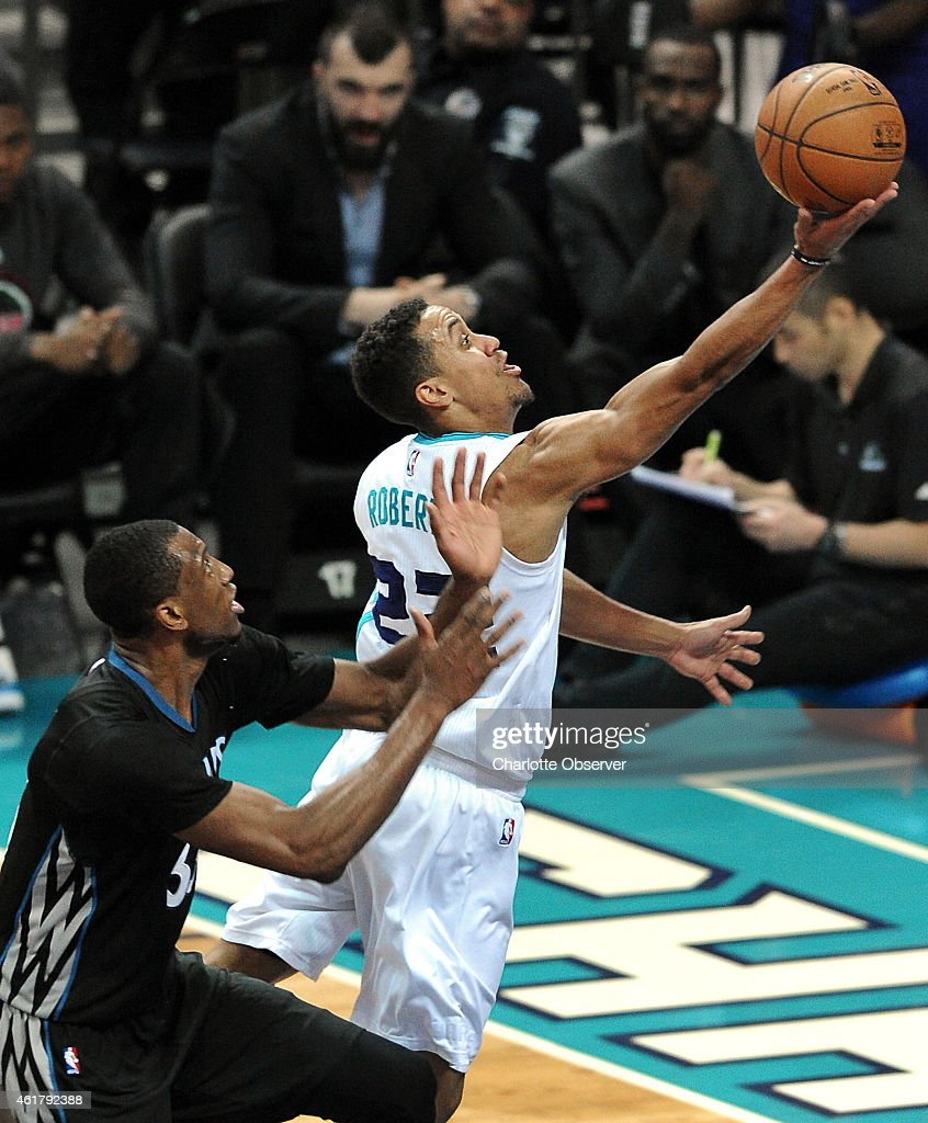 Charlotte Hornets guard Brian Roberts drives to the basket for two points as Minnesota Timberwolves forward Thaddeus Young looks on during second...