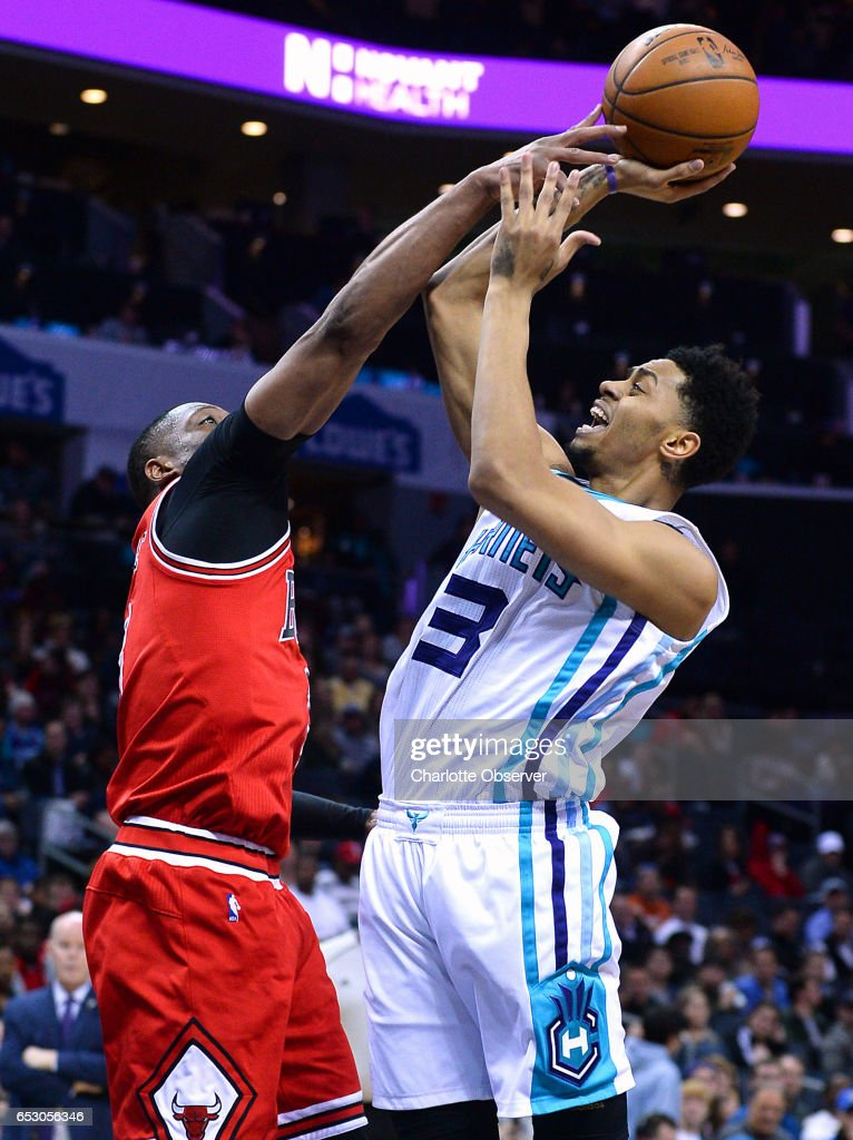 Charlotte Hornets guard Jeremy Lamb, right, fights to get a shot off against Chicago Bulls guard Dwyane Wade, left, during second half action on Monday, March 13, 2017 at the Spectrum Center in Charlotte, N.C. The Bulls defeated the Hornets 115-109.