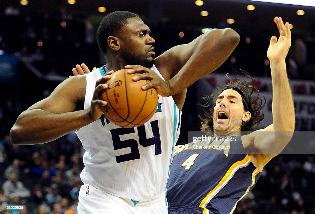 Charlotte Hornets' Jason Maxiell claims a rebound as Indiana Pacers' Luis Scola falls backward during the first half on Sunday Feb 8 at Time Warner...