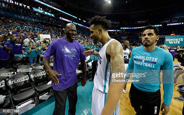 Charlotte Hornets owner Michael Jordan congratulates guard Courtney Lee after the team defeated the Miami Heat on Monday April 25 at Time Warner...