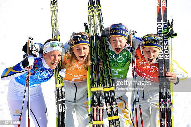 Charlotte Kalla Anna Haag Emma Wiken and Ida Ingemarsdotter of Sweden celebrate winning the gold medal in the Women's 4 x 5 km Relay during day eight...