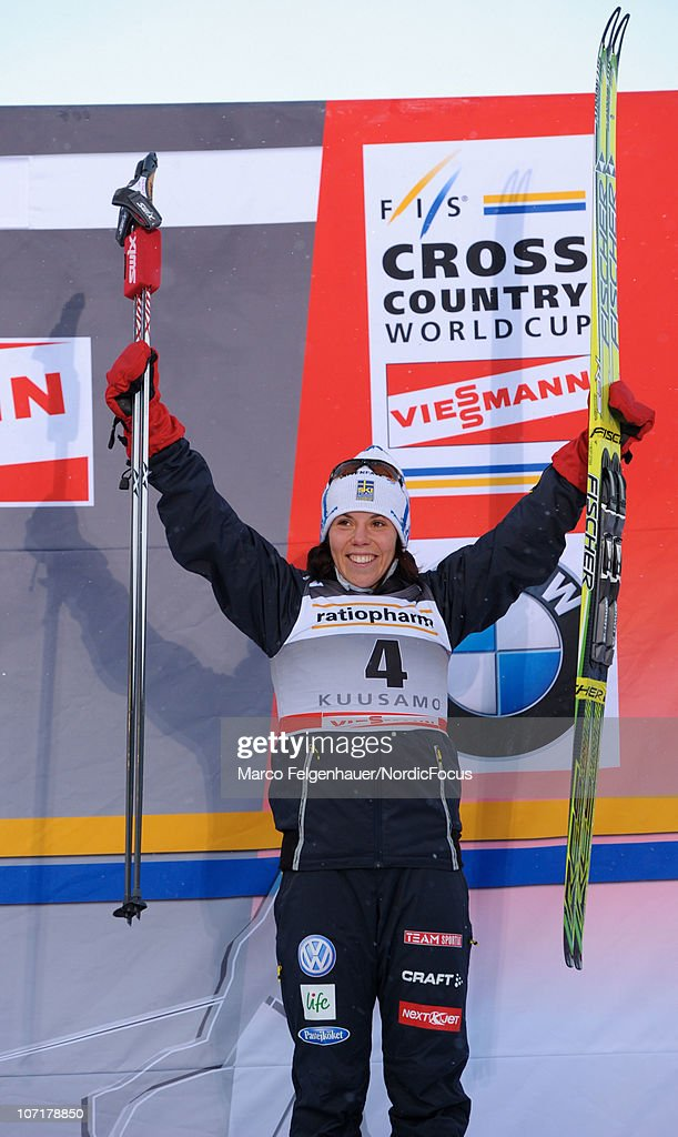 Charlotte Kalla of Sweden celebrates her third place in the women 10km free handicap start during the FIS World Cup Cross Country Skiing on November 28, 2010, in Kuusamo, Finland.