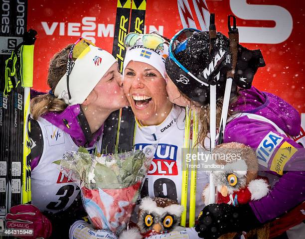 Charlotte Kalla of Sweden celebrates winning the gold medal with Jessica Diggins of USA and Caitlin Gregg of USA at the Ladies 100 km Individual Free...
