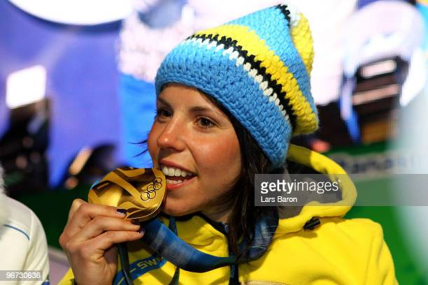 Charlotte Kalla of Sweden celebrates with the gold medal during the medal ceremony for the CrossCountry Skiing Ladies' 10 km Free at Whistler Medals...