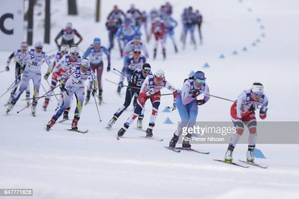 Charlotte Kalla of Sweden Heidi Weng of Norway Krista Parmakoski of Finland and Marit Bjorgen of Norway during the women's cross country mass start...