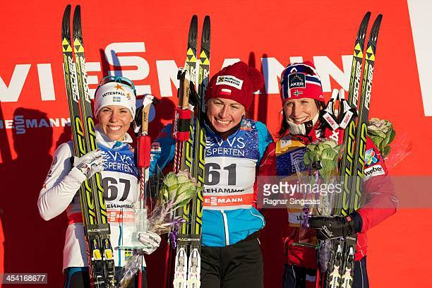 Charlotte Kalla of Sweden Justyna Kowalczyk of Poland and Marit Bjoergen of Norway pose on the podium during the FIS CrossCountry World Cup Women's...