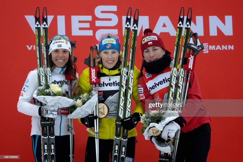 Charlotte Kalla of Sweden, Kikkan Randall of the United States and Justyna Kowalczyk of Poland celebrate at the podium after the Women's 3.1km Free Individual Prolouge at DKB Ski Arena on December 29, 2012 in Oberhof, Germany.