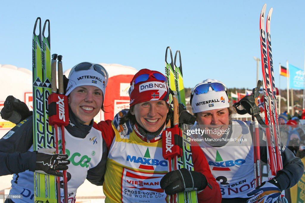 Charlotte Kalla of Sweden (2nd place), Marit Bjoergen of Norway (winner), Anna Haag of Sweden (3rd place) smile on the podium of the Women's 10km Cross Country Skiing during day one of the FIS World Cup on November 21, 2009 in Beitostoelen, Norway.