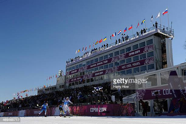 Charlotte Kalla of Sweden takes lead to Krista Lahteenmaki of Finland and Denise Herrmann of Germany to corss the finishing line to win the gold...