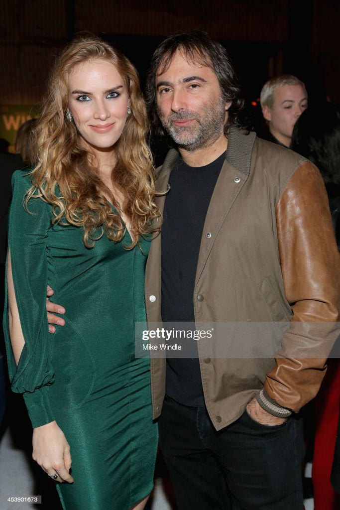 Charlotte Kirk (L) and Joshua Newton attend NYLON + McDonald's Dec/Jan issue launch party, hosted by cover star Demi Lovato on December 5, 2013 in West Hollywood, California.
