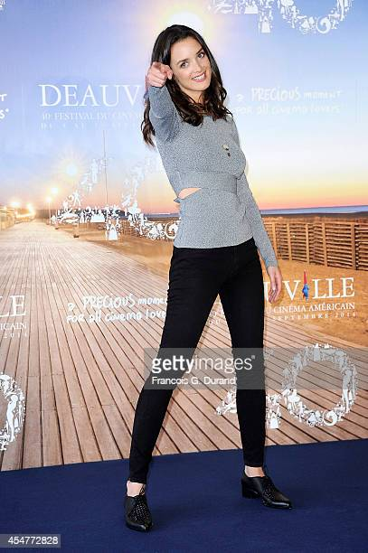 Charlotte Le Bon poses at a photocall during the 40th Deauville American Film Festival on September 6 2014 in Deauville France