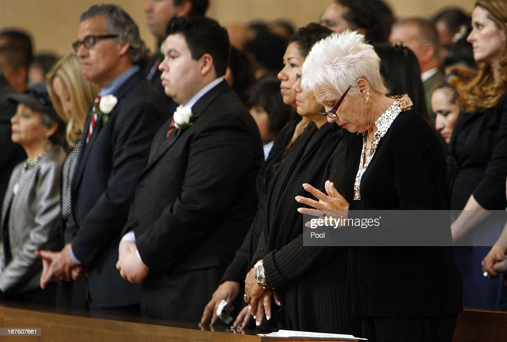 Charlotte Lerchenmuller (R), wife of Sal Castro prays with other family members during the funeral mass for the former teacher at the Cathedral of Our Lady of Angels on April 25, 2013 in Los Angeles, California. Sal Castro was one of the leaders of the 1968 Chicano student walkouts, a protest for better schools that is considered the start of the Chicano movement.