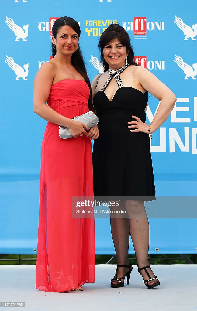 Charlotte Maria Barbera and Anna Maria Barbera attend 2013 Giffoni Film Festival photocall on July 28, 2013 in Giffoni Valle Piana, Italy.