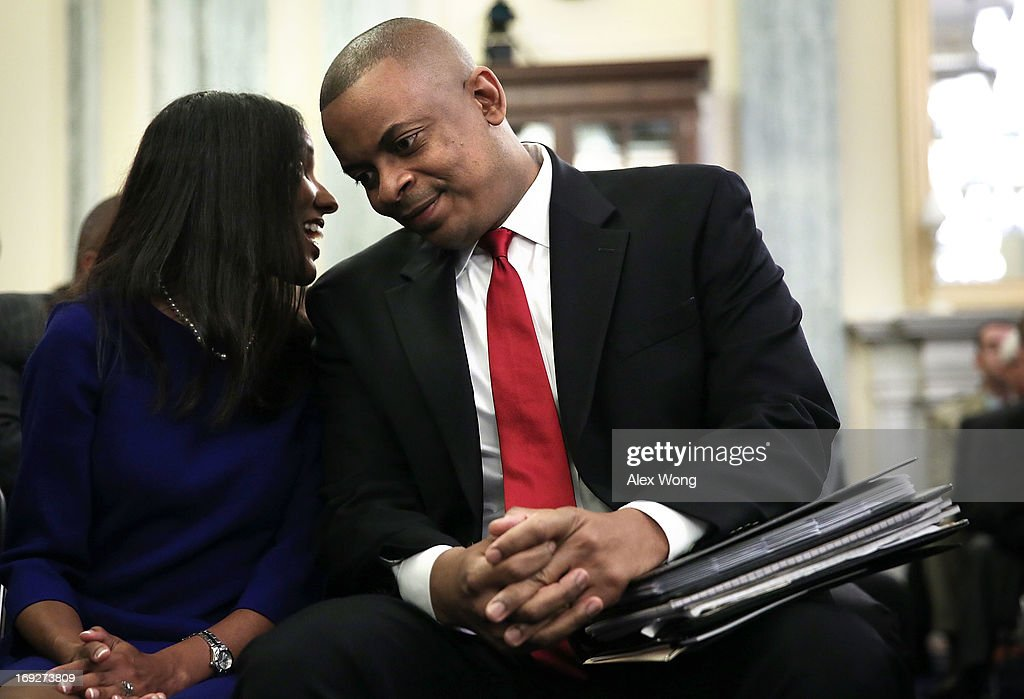 Charlotte Mayor Anthony Foxx listens to his wife Samara Foxx during his confirmation hearing before the Senate Commerce, Science and Transportation Committee May 22, 2013 on Capitol Hill in Washington, DC. Foxx will succeed Ray LaHood to become the next U.S. Secretary of Transportation if confirmed.
