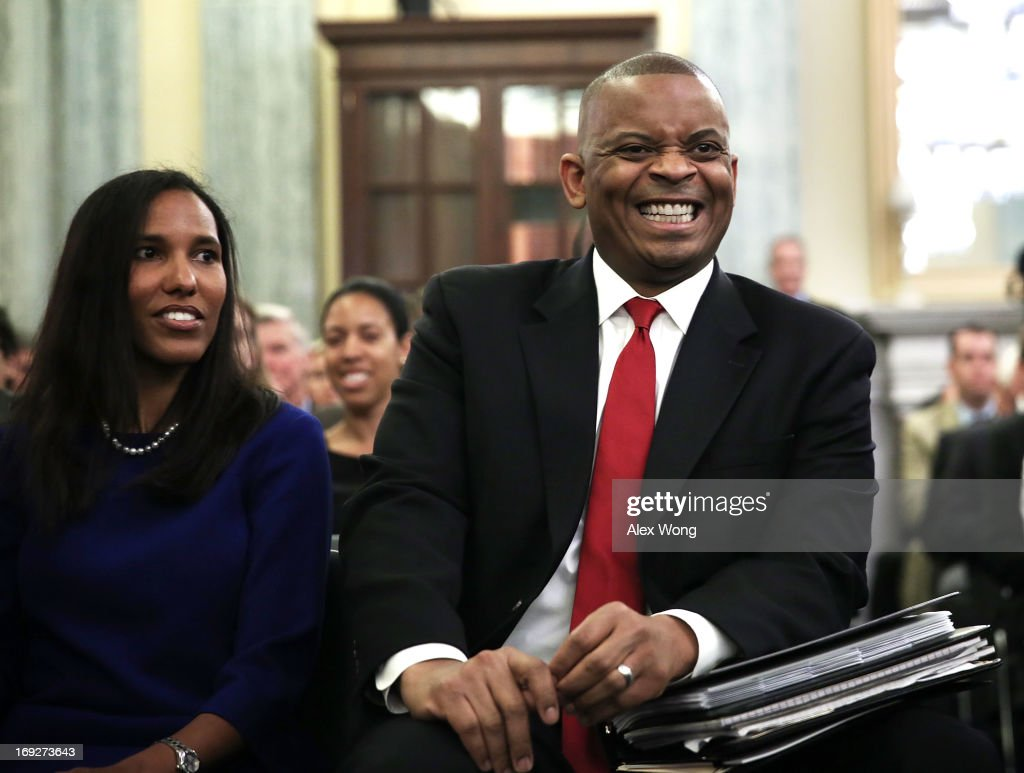 Charlotte Mayor Anthony Foxx reacts as he listens with his wife Samara Foxx during his confirmation hearing before the Senate Commerce, Science and Transportation Committee May 22, 2013 on Capitol Hill in Washington, DC. Foxx will succeed Ray LaHood to become the next U.S. Secretary of Transportation if confirmed.
