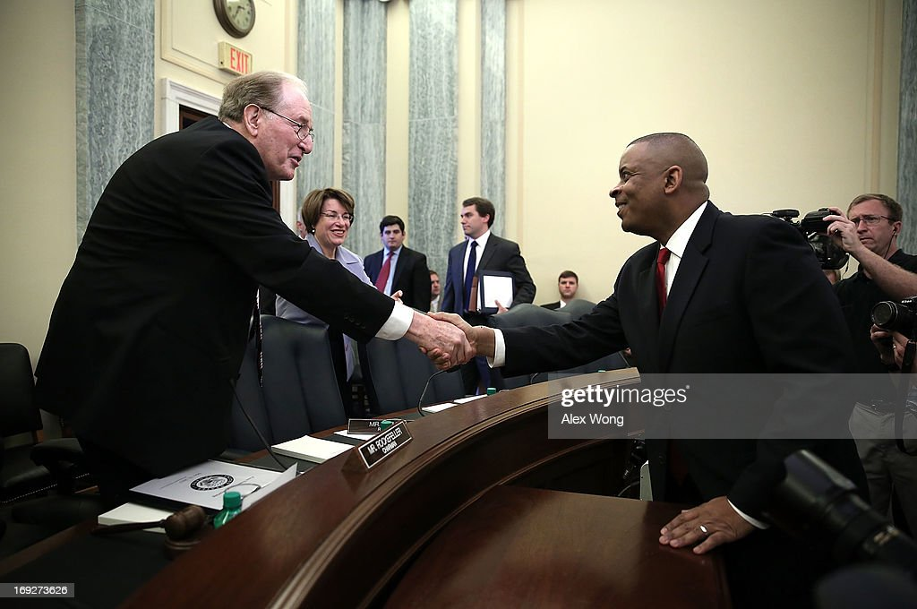 Charlotte Mayor Anthony Foxx (R) shakes hands with Committee Chairman Sen. <a gi-track='captionPersonalityLinkClicked' href=/galleries/search?phrase=Jay+Rockefeller&family=editorial&specificpeople=217570 ng-click='$event.stopPropagation()'>Jay Rockefeller</a> (D-WV) (L) during his confirmation hearing before the Senate Commerce, Science and Transportation Committee May 22, 2013 on Capitol Hill in Washington, DC. Foxx will succeed Ray LaHood to become the next U.S. Secretary of Transportation if confirmed.