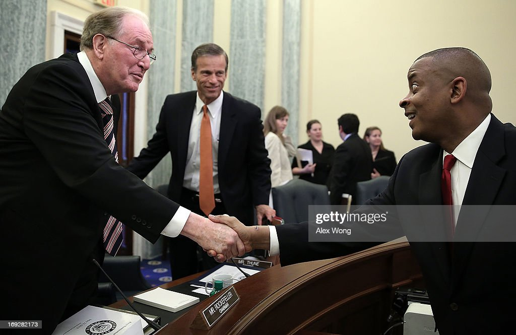 Charlotte Mayor Anthony Foxx (R) shakes hands with Committee Chairman Sen. <a gi-track='captionPersonalityLinkClicked' href=/galleries/search?phrase=Jay+Rockefeller&family=editorial&specificpeople=217570 ng-click='$event.stopPropagation()'>Jay Rockefeller</a> (D-WV) (L) as ranking member Sen. <a gi-track='captionPersonalityLinkClicked' href=/galleries/search?phrase=John+Thune&family=editorial&specificpeople=534356 ng-click='$event.stopPropagation()'>John Thune</a> (R-SD) (C) looks on at the end of his confirmation hearing before the Senate Commerce, Science and Transportation Committee May 22, 2013 on Capitol Hill in Washington, DC. Foxx will succeed Ray LaHood to become the next U.S. Secretary of Transportation if confirmed.