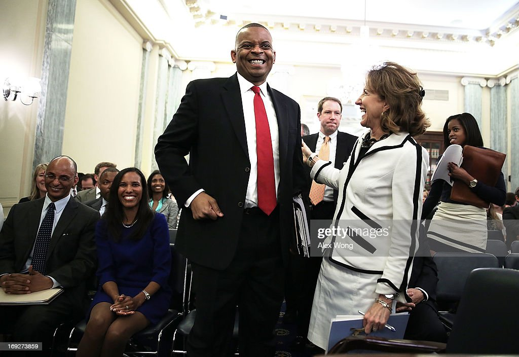 Charlotte Mayor Anthony Foxx shares a moment with U.S. Sen. <a gi-track='captionPersonalityLinkClicked' href=/galleries/search?phrase=Kay+Hagan&family=editorial&specificpeople=5592035 ng-click='$event.stopPropagation()'>Kay Hagan</a> (D-NC) after Hagan introduced Foxx during his confirmation hearing before the Senate Commerce, Science and Transportation Committee May 22, 2013 on Capitol Hill in Washington, DC. Foxx will succeed Ray LaHood to become the next U.S. Secretary of Transportation if confirmed.