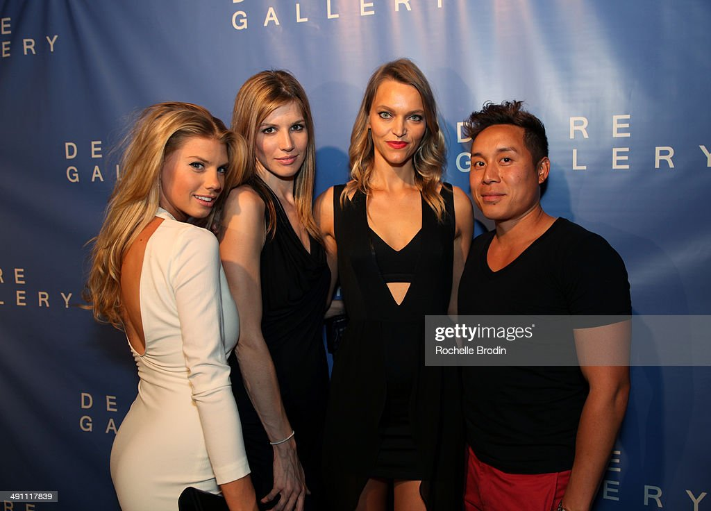 Charlotte Mckinny, Michelle Bof, Sarah DeAnna, and John Tew attend the grand opening of De Re Gallery on May 15, 2014 in West Hollywood, CA.