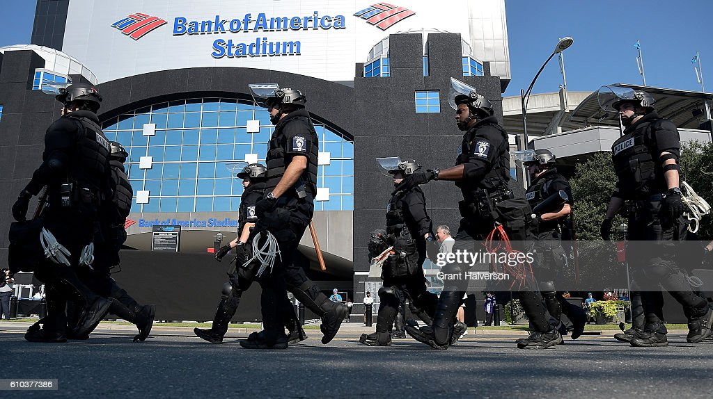 Charlotte Mecklenburg Police Department deploy outside of Bank of America Stadium prior to the game between the Carolina Panthers and the Minnesota Vikings on September 25, 2016 in Charlotte, North Carolina. Charlotte has been the site of civil unrest since Keith Lamont Scott, 43, was shot and killed by police officers at an apartment complex near UNC Charlotte on September 25, 2016.
