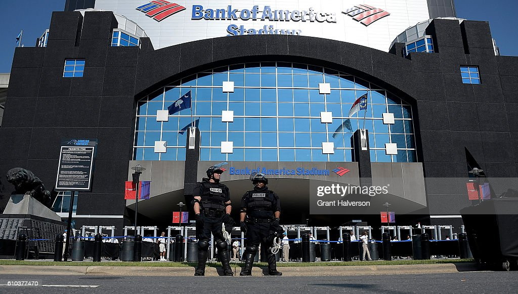 Charlotte Mecklenburg Police Department officers deploy outside of Bank of America Stadium prior to the game between the Carolina Panthers and the Minnesota Vikings on September 25, 2016 in Charlotte, North Carolina. Charlotte has been the site of civil unrest since Keith Lamont Scott, 43, was shot and killed by police officers at an apartment complex near UNC Charlotte on September 25, 2016.