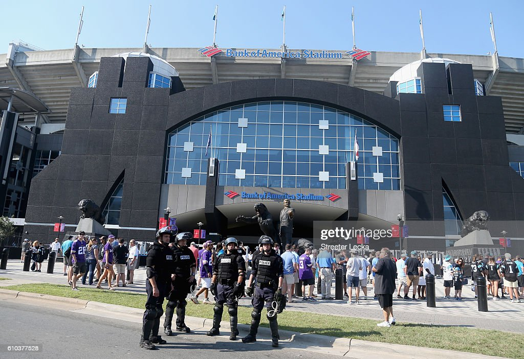 Charlotte Mecklenburg Police Department officers deploy outside of Bank of America Stadium prior to the game between the Minnesota Vikings and Carolina Panthers at Bank of America Stadium on September 25, 2016 in Charlotte, North Carolina. Charlotte has been the site of civil unrest since Keith Lamont Scott, 43, was shot and killed by police officers at an apartment complex near UNC Charlotte.