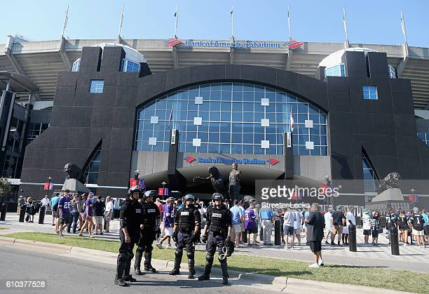 Charlotte Mecklenburg Police Department officers deploy outside of Bank of America Stadium prior to the game between the Minnesota Vikings and...