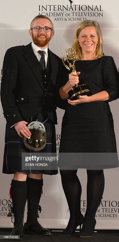 Charlotte Moore, commissioning editor, and Craig Hunter, executive producer, show their awards at the 40th International Emmy Awards November 19, 2012 in New York. The two won for best Documentary for 'Choosing to Die UK.' AFP PHOTO/Stan HONDA