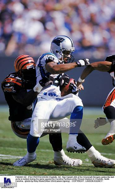 9/26/99 Charlotte NC Rae Carruth of the Cincinnatti Bengals carries the ball as he is tackled during the game against the Carolina Panthers at the...