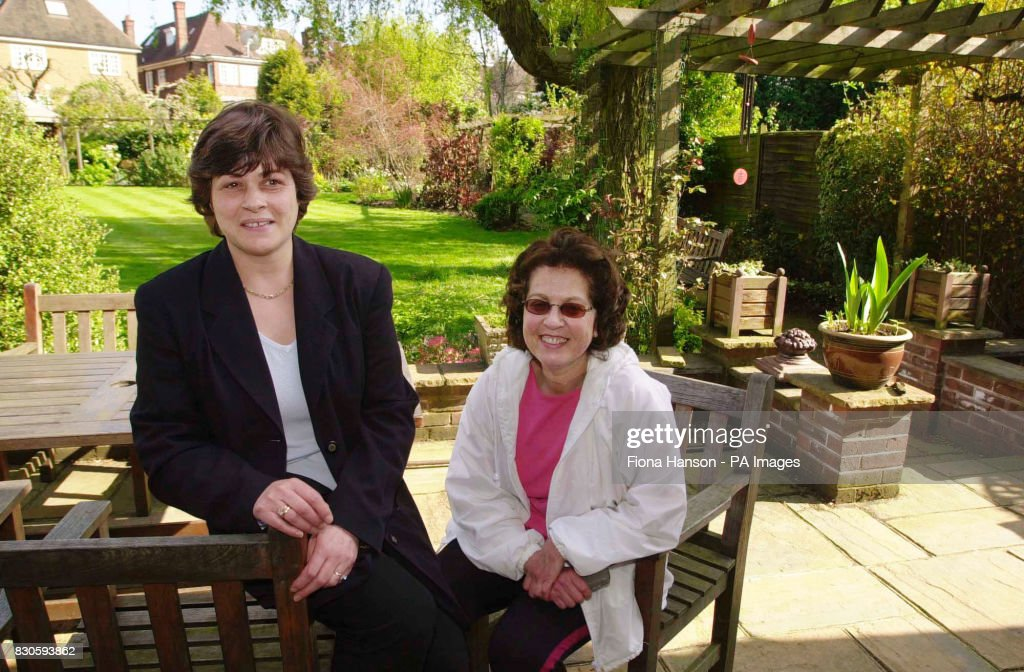 Charlotte Newman (right) in her garden in Charles Hill, London with cleaner Carol Montague who was the first to see a lynx on the patio. The big cat was later captured and is now in London Zoo. * A spokesman for Scotland Yard said officers were called to an address and animal handlers darted the animal to sedate it before taking it to the zoo.