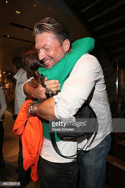 Charlotte Oeynhausen Hardy Krueger jr during the Emporio Armani Friends event at the Armani Caffe on July 29 2015 in Munich Germany